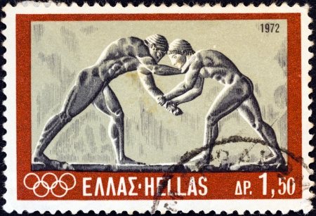GREECE - CIRCA 1972: A stamp printed in Greece from the Olympic Games, Munich issue shows ancient wrestlers (bas-relief), circa 1972.