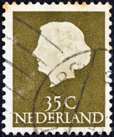 NETHERLANDS - CIRCA 1953: A stamp printed in the Netherlands shows Queen Juliana, circa 1953.  Stock Photo - 17146391