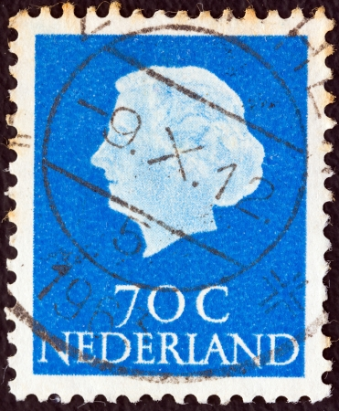 NETHERLANDS - CIRCA 1953: A stamp printed in the Netherlands shows Queen Juliana, circa 1953.  Stock Photo - 17146393