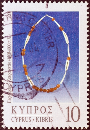 kibris: CYPRUS - CIRCA 2000: A stamp printed in Cyprus from the Jewellery issue shows a necklace from Khirokitia (4.500-4.000 B.C.), circa 2000.