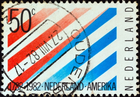 orange nassau: NETHERLANDS - CIRCA 1982: A stamp printed in the Netherlands issued for the bicentenary of Netherlands-United States diplomatic relations shows stripes in national colors, circa 1982.