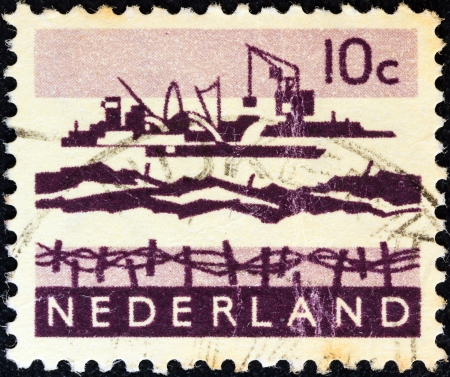 stempeln: NETHERLANDS - CIRCA 1962: A stamp printed in the Netherlands shows Delta excavation works, circa 1962.  Editorial