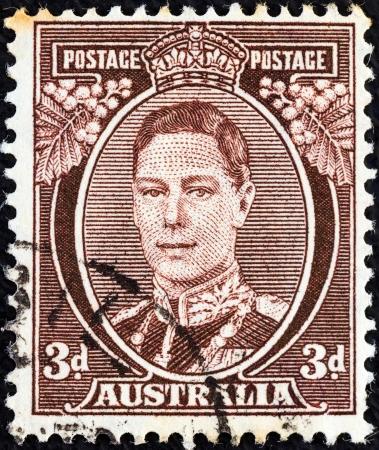 postes: AUSTRALIA - CIRCA 1937: A stamp printed in Australia shows King George VI, circa 1937.