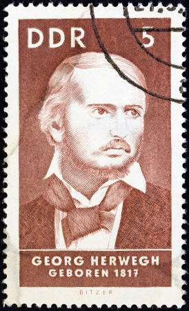 stempeln: GERMAN DEMOCRATIC REPUBLIC - CIRCA 1967: A stamp printed in Germany from the Birth Anniversaries issue shows poet Georg Herwegh (1817), circa 1967.  Editorial