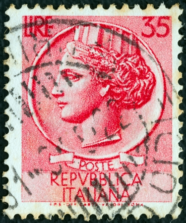 turreted: ITALY - CIRCA 1953: A stamp printed in Italy from the Italy turreted (Syracuse) issue shows an Ancient coin of Syracuse, circa 1953.