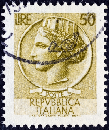 turreted: ITALY - CIRCA 1968: A stamp printed in Italy from the Italy turreted (Syracuse) issue shows an Ancient coin of Syracuse, circa 1968.