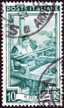 ITALY - CIRCA 1950: A stamp printed in Italy from the Provincial Occupations issue shows a Weaver (Calabria), circa 1950.