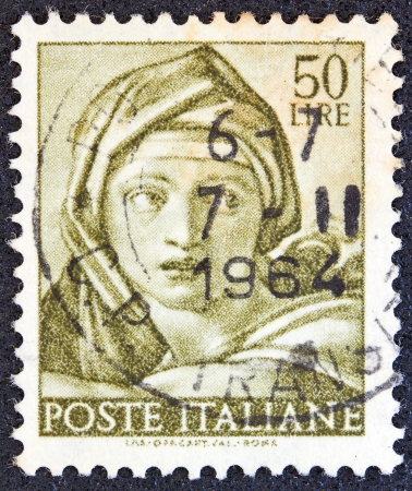 sibyl: ITALY - CIRCA 1961: A stamp printed in Italy from the Michelangelo issue shows the head of Delphic Sibyl from Sistine Chapel, circa 1961.