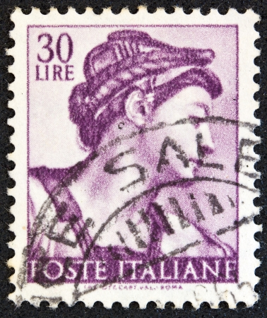sibyl: ITALY - CIRCA 1961: A stamp printed in Italy from the Michelangelo issue shows the head of Erythraean Sibyl from Sistine Chapel, circa 1961.  Editorial