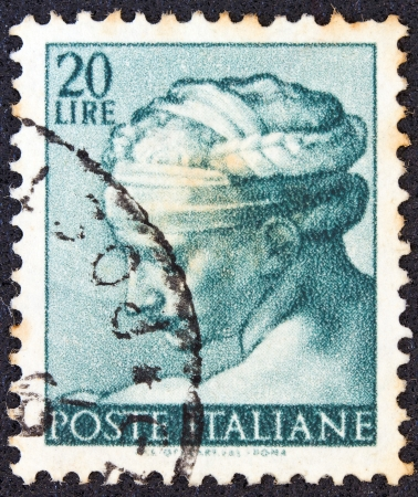 ITALY - CIRCA 1961: A stamp printed in Italy from Michelangelo issue shows the head of Libyan Sibyl from Sistine Chapel, circa 1961.