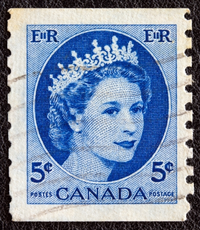 CANADA - CIRCA 1954: A stamp printed in Canada shows a portrait of Queen Elizabeth II, circa 1954.