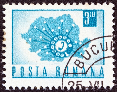 ROMANIA - CIRCA 1967: A stamp printed in Romania shows a Telephone Dial and Map of Romania, circa 1967.