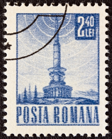 ROMANIA - CIRCA 1967: A stamp printed in Romania shows a T.V. relay station, circa 1967.  Stock Photo - 17403365