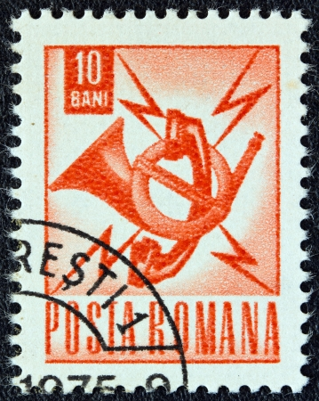 posthorn: ROMANIA - CIRCA 1967: A stamp printed in Romania shows posthorn and telephone emblem, circa 1967.