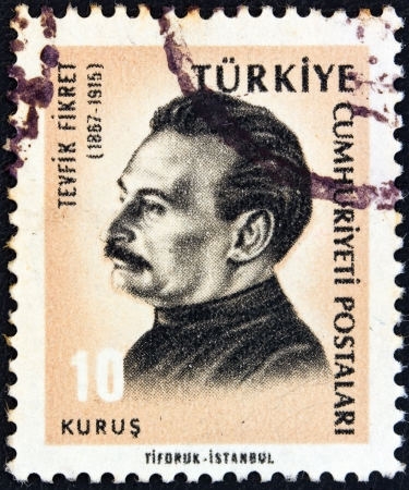 sello: TURKEY - CIRCA 1965: A stamp printed in Turkey from the Cultural Celebrities issue shows poet Tevfik Fikret, circa 1965.