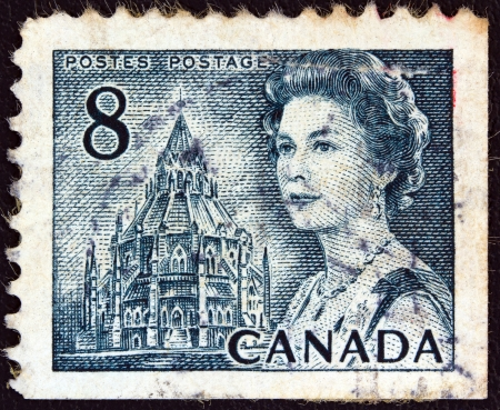 CANADA - CIRCA 1967: A stamp printed in Canada shows a portrait of Queen Elizabeth II and Library of Parliament, circa 1967.  Stock Photo - 17765250