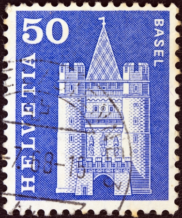 gatehouse: SWITZERLAND - CIRCA 1960: A stamp printed in Switzerland from the Architectural Monuments (1st series) issue shows Spalentor gate, Basel, circa 1960.