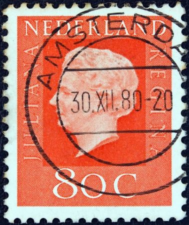 nederlan: NETHERLANDS - CIRCA 1969: A stamp printed in the Netherlands shows Queen Juliana, circa 1969.