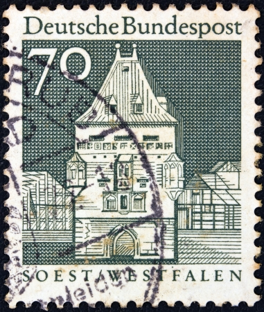 soest: GERMANY - CIRCA 1966: A stamp printed in Germany from the Historic Buildings issue shows Osthofen Gate, Soest, circa 1966.  Editorial