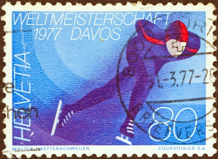 helvetia: SWITZERLAND - CIRCA 1976: A stamp printed in Switzerland issued for the World Speed Skating Championships, Davos, 1977 shows a skater, circa 1976.