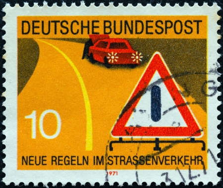 bundes: GERMANY - CIRCA 1971: A stamp printed in Germany from the New Road Traffic Regulations (2nd series) issue shows warning of obstruction sign, circa 1971.