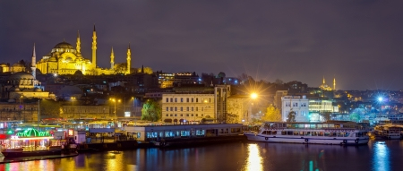 Panoramic view of Eminonu at night with Suleymaniye Mosque, Istanbul, Turkey photo