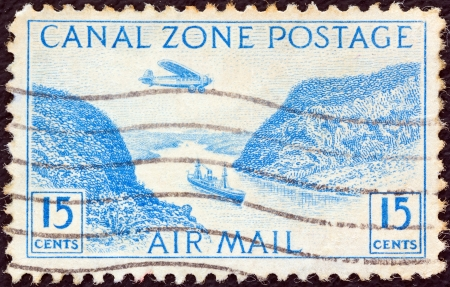 PANAMA CANAL ZONE- CIRCA 1931: A stamp printed in Panama Canal Zone shows a Steamer in Panama Canal, circa 1931.