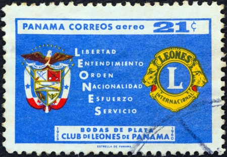 PANAMA - CIRCA 1961: A stamp printed in Panama issued for the 25th anniversary of Lions Club shows Lions emblem, arms and slogan, circa 1961.
