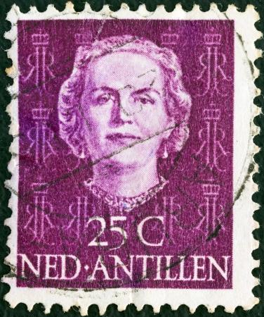 nederlan: NETHERLANDS ANTILLES - CIRCA 1950: A stamp printed in the Netherlands shows Queen Juliana, circa 1950.  Editorial