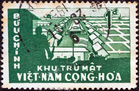 co operative: SOUTH VIETNAM - CIRCA 1960: A stamp printed in South Vietnam from the Establishment of Co-operative Rice Farming issue shows Co-operative Farm, circa 1960.