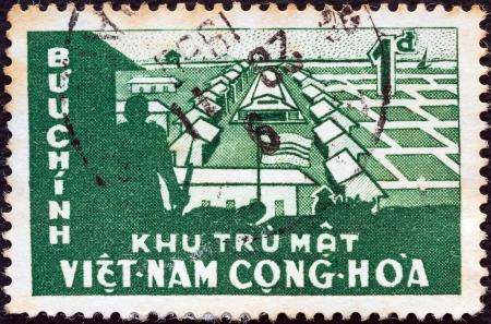 """cooperativa: SOUTH VIETNAM - CIRCA 1960: Un sello impreso en Vietnam del Sur a partir de la """"Creaci�n de Cooperativas de Cultivo de Arroz"""" cuesti�n muestra Cooperativa agr�cola, alrededor de 1960. Editorial"""
