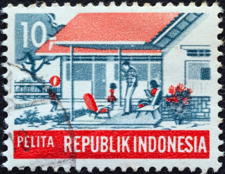 pelita: INDONESIA - CIRCA 1969: A stamp printed in Indonesia from the Five-year Development Plan issue shows Modern family (Social Welfare), circa 1969.
