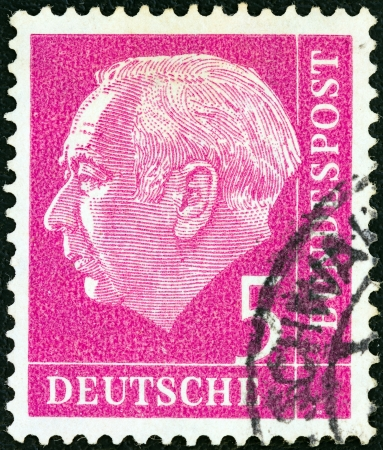 stempeln: GERMANY - CIRCA 1954: A stamp printed in Germany shows the first President of the Federal Republic of Germany Theodor Heuss, circa 1954.