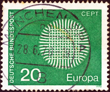 bundes: GERMANY - CIRCA 1970: A stamp printed in Germany from the Europa issue shows a flaming sun, circa 1970.  Editorial