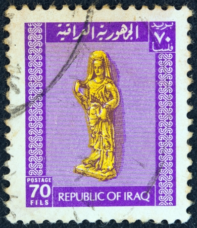 IRAQ - CIRCA 1973: A stamp printed in Iraq shows a statue of a Goddess, circa 1973.
