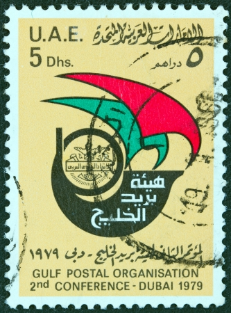 posthorn: UNITED ARAB EMIRATES - CIRCA 1979: A stamp printed in United Arab Emirates issued for the 2nd Gulf Postal Organization Conference at Dubai, circa 1979.