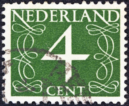 nederlan: NETHERLANDS - CIRCA 1946: A stamp printed in the Netherlands shows its value of 4 cent, circa 1946.  Editorial