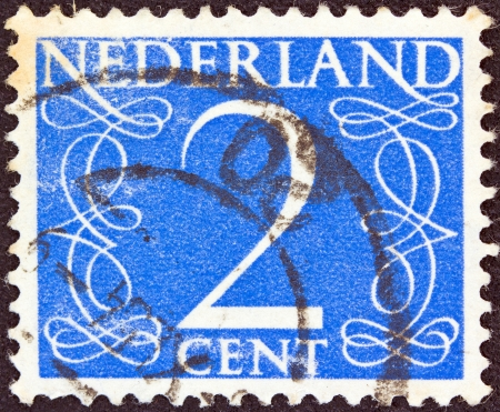 nederlan: NETHERLANDS - CIRCA 1946: A stamp printed in the Netherlands shows its value of 2 cent, circa 1946.