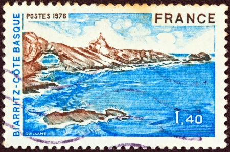 postes: FRANCE - CIRCA 1976: A stamp printed in France from the Tourist Publicity issue shows Basque coast, Biarritz, circa 1976.