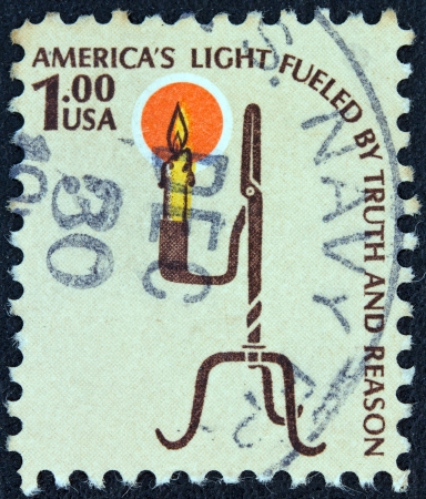 fueled: USA - CIRCA 1975: A stamp printed in USA from the Americana issue shows the Rush Lamp and Candle Holder and the inscription Americas Light Fueled by Truth and Reason, circa 1975.  Editorial