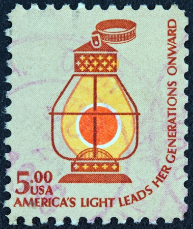 onward: USA - CIRCA 1975: A stamp printed in USA from the Americana issue shows a railroad conductors lantern (c. 1850) and the inscription Americas Light Leads Her Generations Onward, circa 1975.  Editorial