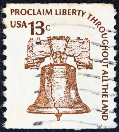 USA - CIRCA 1975: A stamp printed in USA from the Americana issue shows the Liberty Bell and the inscription Proclaim Liberty Throughout All the Land, circa 1975.
