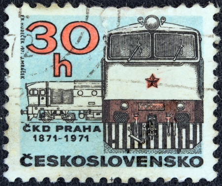 stempeln: CZECHOSLOVAKIA - CIRCA 1971: A stamp printed in Czechoslovakia issued for the 100 years of Prague C.K.D. Locomotive Works shows Class T478.3 Diesel Locomotive, circa 1971.