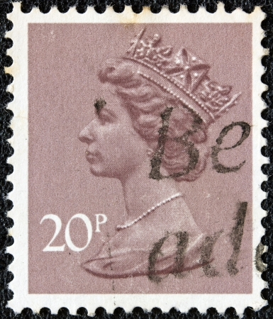 UNITED KINGDOM - CIRCA 1971: A stamp printed in United Kingdom showing a portrait of Queen Elizabeth II, circa 1971.  Stock Photo - 18468929