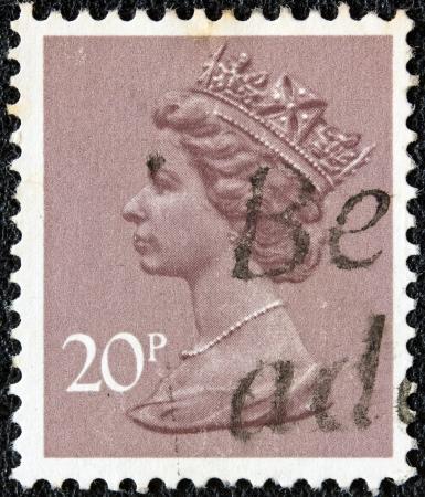 UNITED KINGDOM - CIRCA 1971: A stamp printed in United Kingdom showing a portrait of Queen Elizabeth II, circa 1971.  Stock Photo - 18468929