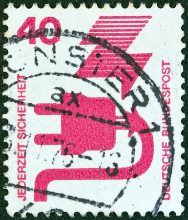 bundespost: GERMANY - CIRCA 1971: A stamp printed in Germany from the Accident Prevention issue shows a faulty electric plug, circa 1971.  Editorial