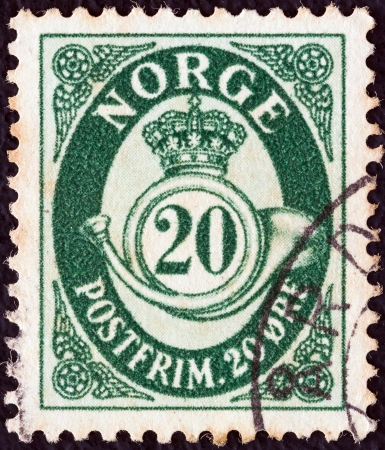 posthorn: NORWAY - CIRCA 1937: A stamp printed in Norway shows crown, post horn and value, circa 1937.  Editorial