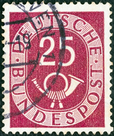 bundes: GERMANY - CIRCA 1951: A stamp printed in Germany shows Numeral value and Posthorn, circa 1951.