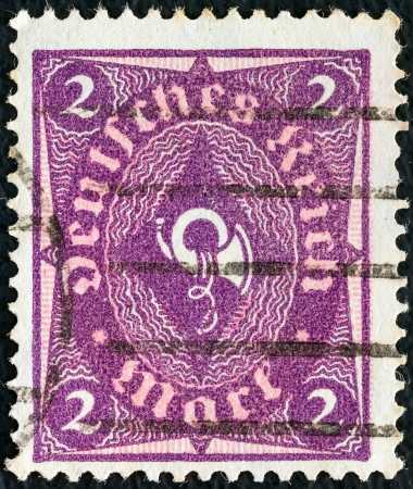 bundes: GERMANY - CIRCA 1921: A stamp printed in Germany shows a posthorn, circa 1921.