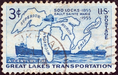 centenary: USA - CIRCA 1955: A stamp printed in USA issued for the Soo Locks centenary shows The Great Lakes and Altadoc (freighter), circa 1955.